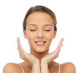 beauty, people, skincare and health concept - smiling young woman face and hands